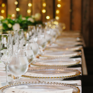 Wedding Tablescape with Lights and Gold Chargers