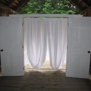 White wood doors arch