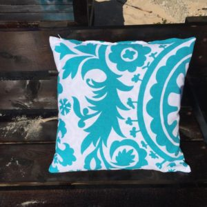 Turquoise Pillow with Floral Design
